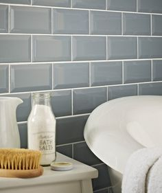 Add Subtle Victorian Blue Colour to Your Kitchen Splashback or Bathroom Walls with these classic Dusty Blue Subway Tiles Beautiful gloss brick-shaped blue bevelled edge wall tiles Kitchen Wall Tiles, Ceramic Wall Tiles, Wall And Floor Tiles, Kitchen Doors, Blue Subway Tile, Topps Tiles, Buy Tile, Downstairs Toilet, Metro Tiles
