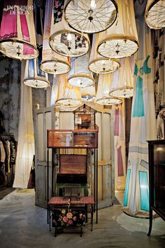 Grandma's attic goes surreal with pendant fixtures fashioned from vintage petticoats and bicycle wheels at Antonio Marras, occupying a former auto-repair shop in Milan.