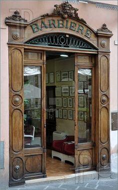 wooden street window of old barber shop