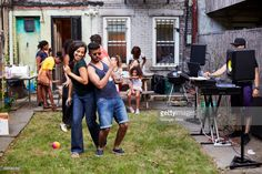 Couple dancing at backyard party