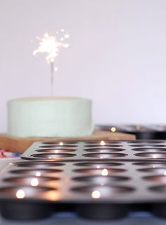 Tea lights in cupcake trays for the party table!
