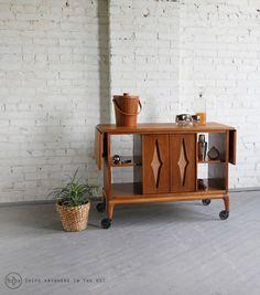 Wooden bar carts offer a warm, vintage edge.