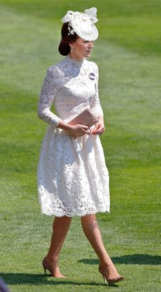 Kate Middleton wore an Alexander McQueen lace dress, with a matching off-white fascinator with floral beading and nude-coloured shoes to attend the Royal Ascot, June 2017.