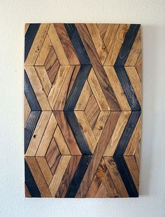This piece is made to order. Lead time for shipping is 1 to 2 weeks  This piece is made with reclaimed wood and the dark brown wood pieces are English walnut wood. It can be hanged vertically or horizontally and the frame is optional. This piece would add a modern look anywhere in your home! We can make this same piece with different sizes and colors as well, please contact us for more information! Size: 12X24 24X36  Proper hangers are attached for easy hanging. Self drilling drywall screws…