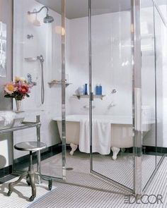 {inspiration for master bath} tear out the current shower/tub and wall separating them - add seamless glass wall, re-tile, put a clawfoot tub in the now oversized shower