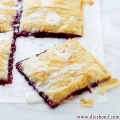 Phyllo Raspberry Pop Tarts with Vanilla Glaze: Layers of Phyllo Sheets filled with Raspberry Jam and topped with a sweet Vanilla Glaze.