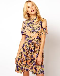 I love everything about this dress except the hole in the shoulder.... :P That would bug me a lot.