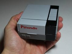 The NES is already fairly portable if you don't mind sticking it in a backpack and going over to a friend's house to play some classic Super Mario Bros., b