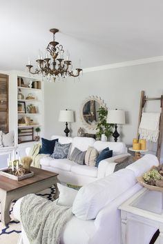 Farmhouse Living room decorated for fall with navy, green, gray, and a pop of…
