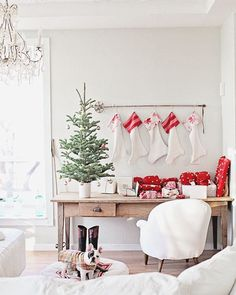 """Dreamy Whites Lifestyle on Instagram: """"One of my favorite ways to hang our stockings during the holidays is from a Belgian ski pole. The stockings you can find in our online shop. {Christmas morning 2013}"""""""