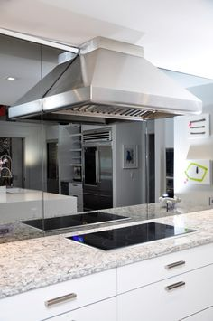 beautiful modern kitchen update - light granite countertops, white cabinets, smooth black stove top... by the BEST custom construction company in central Florida | www.allinconstruction.com