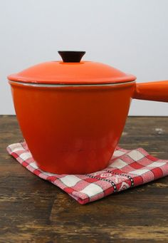 Oranje fonduepannetje met deksel Le Creuset