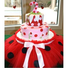 Ladybug Cake Tutu Stand. I like this concept just in a different color scheme