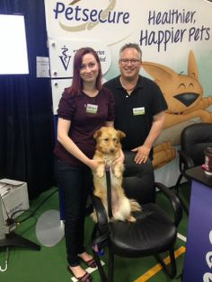 Charlie poses with Petsecure territory managers Christie and Tory. — at Vancouver Island Pet Expo.