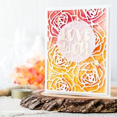 handmade love card .. bright and beautiful watercolor background in yellows and pinks ... white die cut rose background ... sentiment heat embossed on vellum circle ... Wplus9 ... creation from  http://limedoodledesign.com/2016/05/supplies-two-ways/