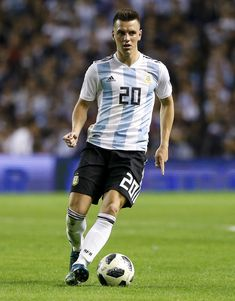 Giovani Lo Celso Photos - Giovani Lo Celso of Argentina drives the ball during an international friendly match between Argentina and Haiti at Alberto J. Armando Stadium on May 2018 in Buenos Aires, Argentina. Argentina Football Team, Fifa, Soccer, Running, Men, Sport, Photos, Manish, Football Pictures