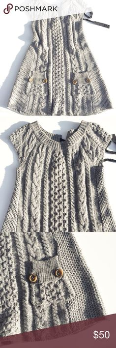 FREE PEOPLE knitted dress size small Cool and warm with black tie detail in the back. Length appx 35.  Thank you for visiting my closet. Please feel free to ask any questions. 99% of the time I ship the next day. Free People Dresses