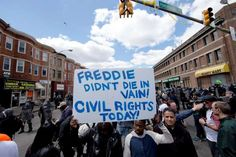 People gather Tuesday, April 28, 2015, in Baltimore, in the aftermath of rioting following Monday's funeral for Freddie Gray, who died in police custody. Gov. Larry Hogan said at a news conference Tuesday that Baltimore will not have a repeat of the riots that happened on Monday.  -  © AP Photo/Matt Rourke
