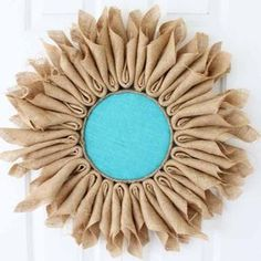 Are you ready to learn how to make burlap flowers? This quick and easy project is perfect for hanging on your walls or even adding to a door as a wreath. I used brown burlap Burlap Flower Wreaths, Sunflower Wreaths, Deco Mesh Wreaths, Fall Wreaths, Diy Wreath, Wreath Ideas, Door Wreaths, Wreath Burlap, Wreath Crafts