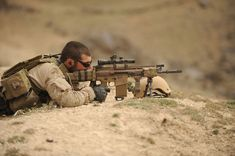 A Navy SEAL takes aim with a MK 17 Mod 0 SCAR-H 7.62mm x 51mm rifle during an operation with Afghan soldiers in northern Zabul province, Afghanistan. The MK17 Mod 0 is a modular weapon system that can be configured as a carbine, assault rifle and sniper rifle.