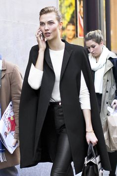 Photos via: Altamira | Models Karlie Kloss killing it during New York Fashion Week in a classic cape...