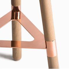 A metal and wood barstool.: