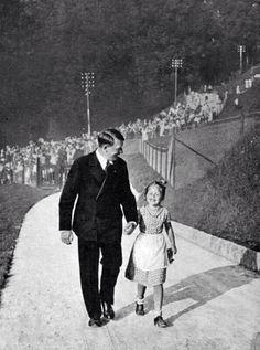 Hitler walking with girl