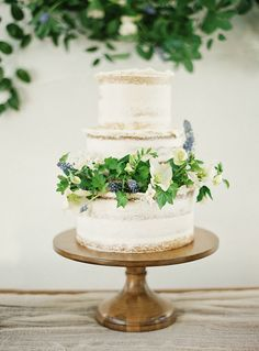 Frosted naked cake with greenery