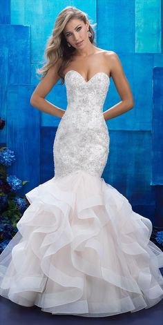 Ruffles create an exaggerated silhouette for this strapless mermaid gown.