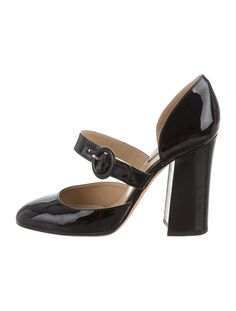 From the Fall/Winter 2013 Collection. Black patent leather Dolce & Gabbana semi pointed-toe pumps with tonal stitching, covered heels and buckle closures at uppers.
