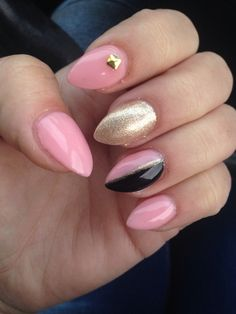 Pink black and gold pointy nails. One of my favourite designs I've had yet.