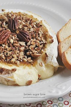 Brie covered in melted brown sugar and pecans is delicious. Brown Sugar Brie will be the hit of any party.