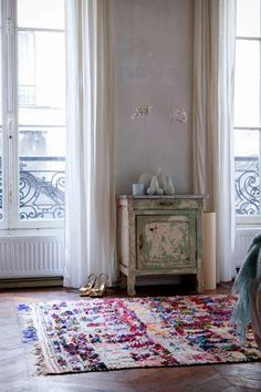 What an interesting rug! The texture and colour completely lifts the room up and fights against the stripped, pale green cupboard and white walls