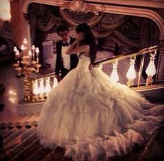 wow! now thats a wedding dress you'd really have to hang onto that railing dragging that train behind you
