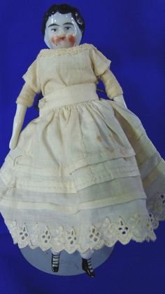 """.99 cent auction___ China Head Doll Miniature Dollhouse Size Antique 1880s Home Decor Collect Toy As___ Hi there...... known as the Victorian 'penny dolls"""" is the 6"""" China head doll circa 1880s, unsigned but attributed to Germany, maybe Herwig, she has the cloth body and China lower limbs, and one of the legs has the blue painting."""