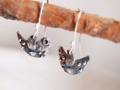 Cute sterling silver bird earrings! I have used seven tiny balls on them. It is from sterling silver. I have oxidized and partly polished it. All