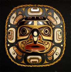 A Wide Moon mask depicting the four stages of the moon, as well as the ebb and flood tides. The moon serves as one of the Native American symbols in the First Nations Kwakwaka'wakw culture. This moon mask is carved from red cedar and has copper inlays.