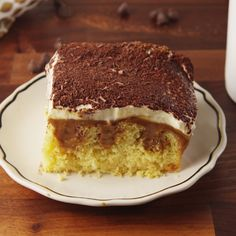 Poke Cake This classic dessert gets the poke cake treatment!This classic dessert gets the poke cake treatment! Tiramisu Poke Cake Recipe, Poke Cake Recipes, Dessert Recipes, Trifle Recipe, Easy Desserts, Delicious Desserts, Yummy Food, Yummy Treats, Sweet Treats