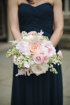 Bridesmaids in navy blue gowns carried pink and ivory bouquets featuring roses, peonies, and verdure. #WeddingBouquet Photography: Millie Holloman. Photography Read More: http://www.insideweddings.com/weddings/navy-blue-gold-and-ivory-wedding-at-duke-university/558/