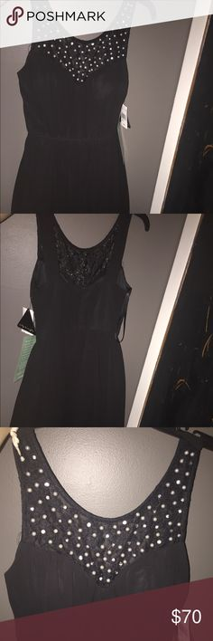 Black Formal Dress I am 5,2 weighing around 125 pounds, this dress goes to about my knee length and has never been worn City Triangles Dresses