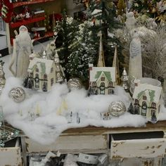 This snowy village tablescape adds frosty elegance with mercury glass and vintage houses.