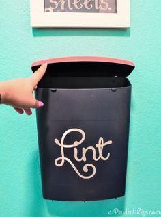 If you don't have space for a full-size trash can in your laundry room, a hanging bin is a handy way to hold lint until trash day. Click through for the tutorial and more laundry room DIYs.