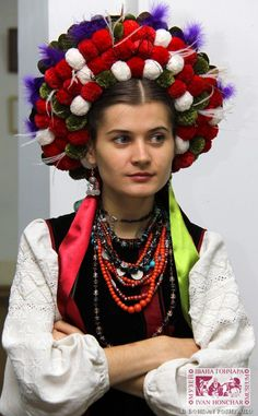 Eastern Europe | Portrait of a woman wearing traditional clothes and headdress, a vinok, Ukraine #pompom #beads