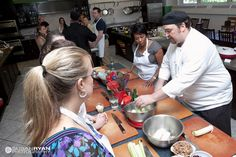Chef John explains the process of making a dish during a private party at The Chopping Block.