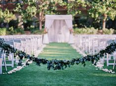 garland drawn across the aisle, outdoor wedding ceremony - Melissa Jill Photography
