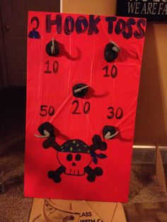 Pirate party ring toss game- dollar tablecloth over a piece of leftover drywall (could use cardboard) attached hooks from dollar store. $6 total!