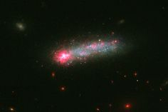 NASA's Hubble Space Telescope has captured a spectacular fireworks display in a small, nearby galaxy, which resembles a July 4th skyrocket.  A firestorm of star birth is lighting up one end of the diminutive galaxy Kiso 5639. The dwarf galaxy is shaped like a flattened pancake, but because it is tilted edge-on, it resembles a skyrocket, with a brilliant blazing head and a long, star-studded tail. http://hubblesite.org/newscenter/archive/releases/2016/23/