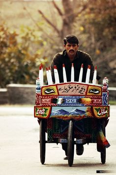 "Pakistan is known for having trucks, cars, and pretty much any vehicle decorated with intricate designs and wise or witty sayings. This one loosely translates to: ""Surely look, but with love"""