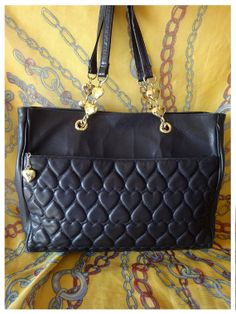 0a254a9480f0 Vintage MOSCHINO black heart shape quilting lambskin tote bag with golden  heart charms. Chic and functional