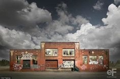 Decline and revival: This abandoned brick building covered with graffiti appears transformed when juxtaposed with stormy clouds